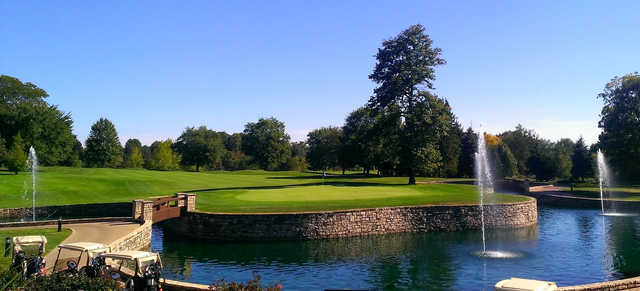 A view of a green surrounded by water at Westfield Country Club.