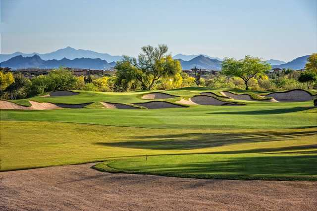 A sunny day view of a hole protected by a collection of bunkers from Palmer Course at Wildfire Golf Club at Desert Ridge.