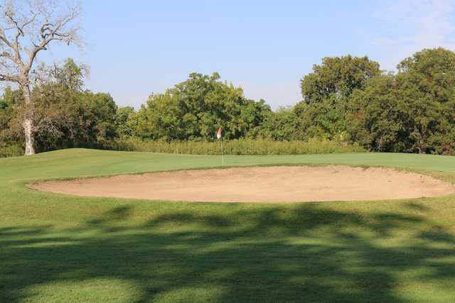 A view of a hole protected by a huge bunker at Willow Springs Golf Course.