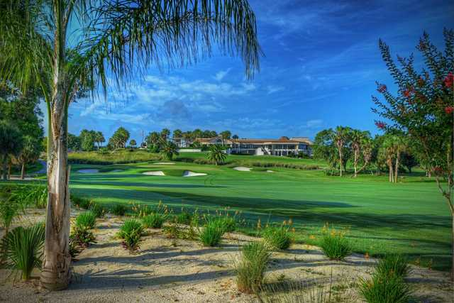 A view of a green surrounded by bunkers at Sugar Mill Country Club.