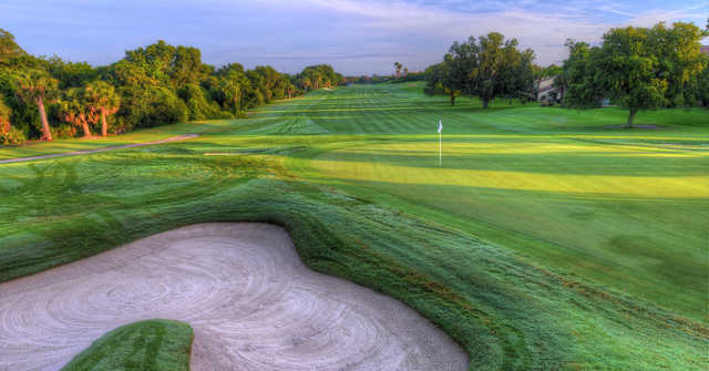 A sunny day view of a hole at Sugar Mill Country Club.