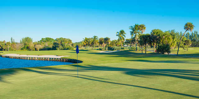 A sunny day view of a hole at Palm Beach National Golf Course.
