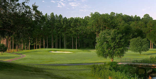 A sunny day view of a green at Cross Creek Country Club.