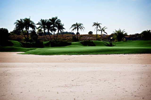 A view of a green with sand coming into play at Grand Harbor Golf & Beach Club.
