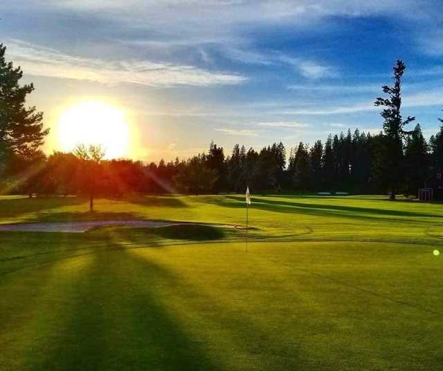 A sunny day view of a hole at Avondale Golf & Tennis Club.