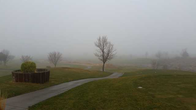 A view of a tee surrounded my mist at Isleta Eagle Golf Course.