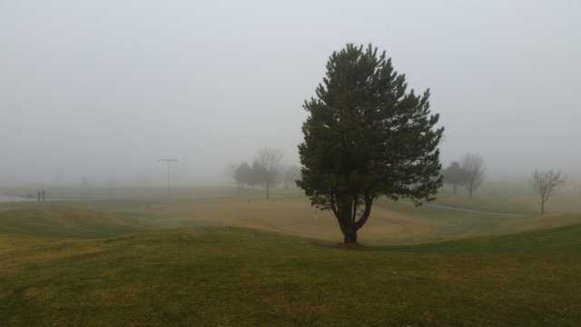A view of the practice area surrounded by mist at Isleta Eagle Golf Course.