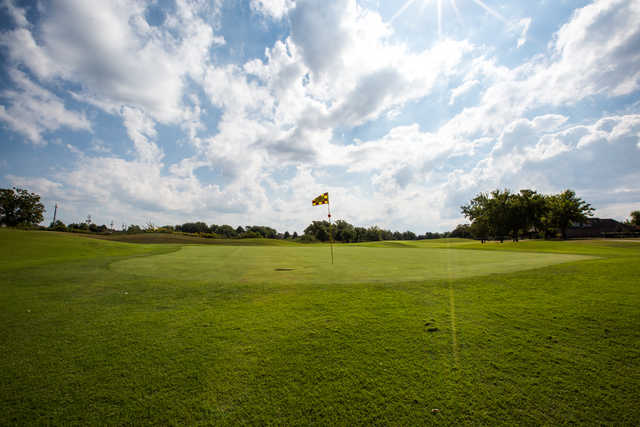 A sunny day view of a hole at Battle Creek Golf Club.