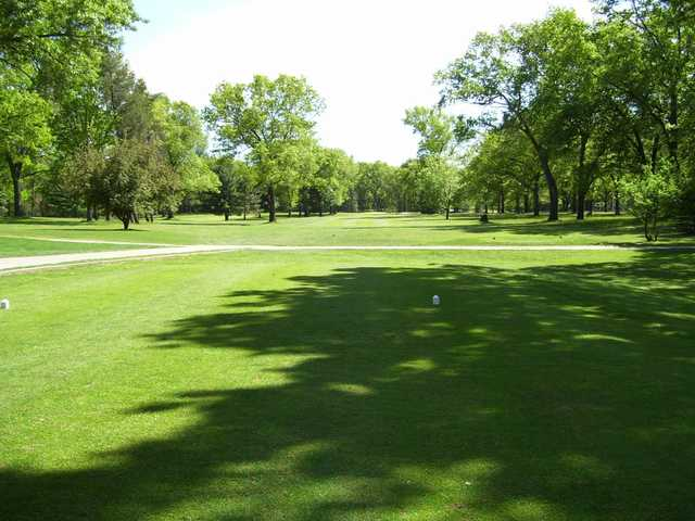 A sunny day view from a tee at Marquette Trails Golf Club.