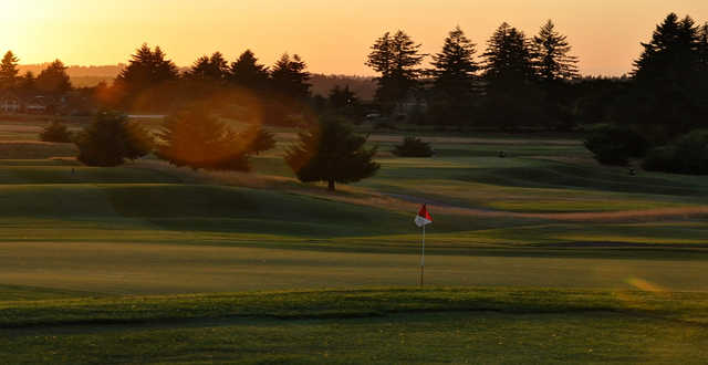 A sunset view of green #8 at Stone Creek Golf Club.