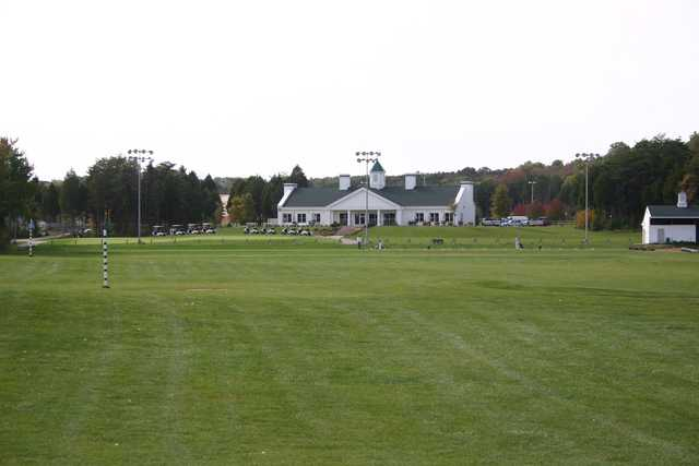 A view of the driving range and the clubhouse at Broad Run Golf & Practice Facility.