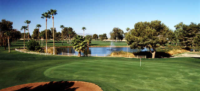A view of a green guarded by a pond at Francisco Grande Resort & Golf Club.
