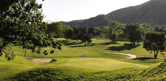 A sunny day view of a green at Green River Golf Club.