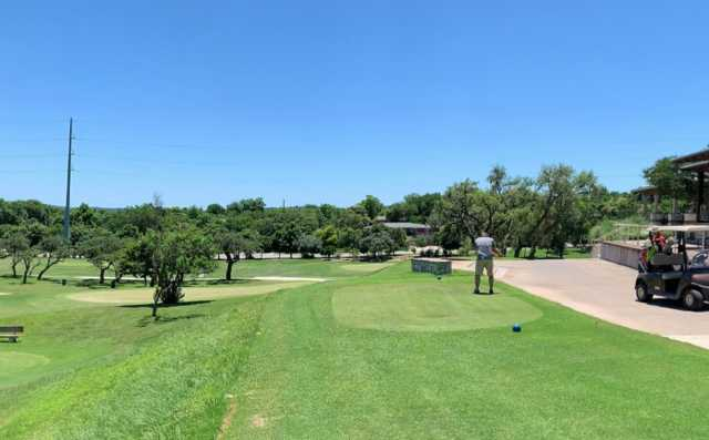 A view of a blue tee and a green at Scott Schreiner Golf Club.