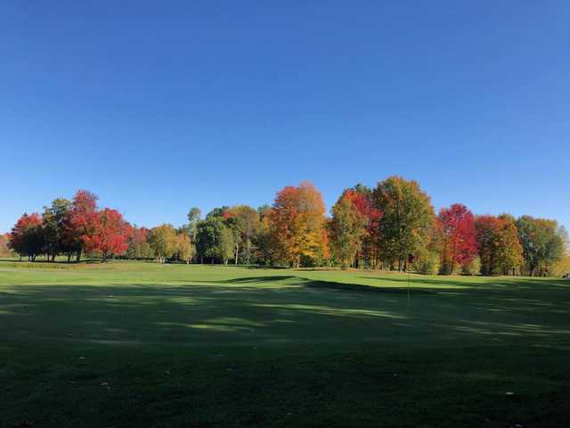A sunny day view of a green at Upper Canada Golf Course.