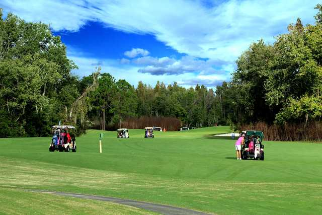 A sunny day view of a hole at Big Cypress Golf & Country Club.
