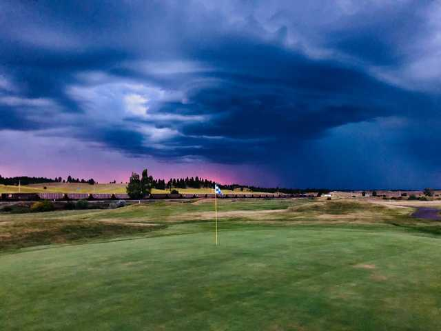 A cloudy day view of a hole at Ponderosa Butte Golf Course.