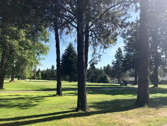 A sunny day view of a fairway at Twin Lakes Village Golf Course.