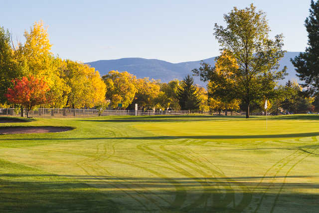 A fall day view of a green at Larchmont Golf Course.