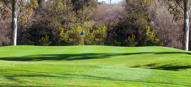 A fall day view of a hole at Brea Creek Golf Course.
