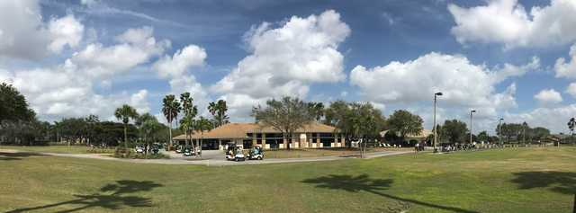 Panoramic view of the clubhouse and driving range at Stoneybrook Golf Club.