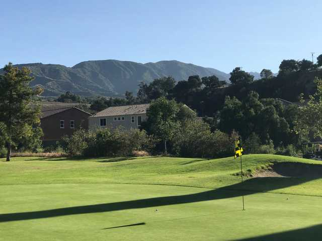 A sunny day view of a hole at San Dimas Canyon Golf Course.