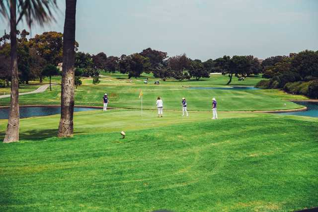 A sunny day view of a green at SeaCliff Country Club.