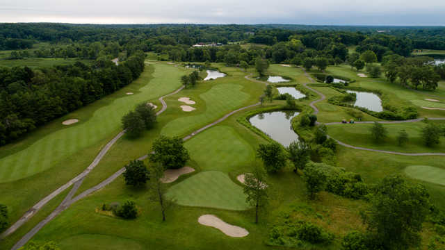 Aerial view of the 8th green and fairway with the 3rd fairway on the left side and the 7th tee on the right side.