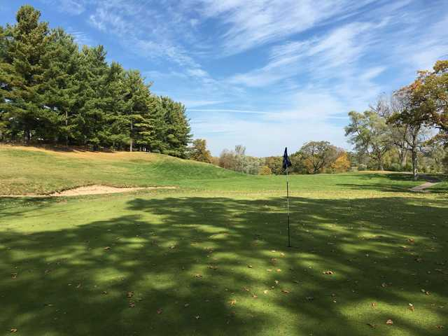 A fall day view of a hole at Mystic Creek Golf Club.