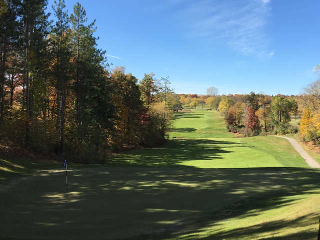 A view of a green with a narrow path on the right side at  Mystic Creek Golf Club .