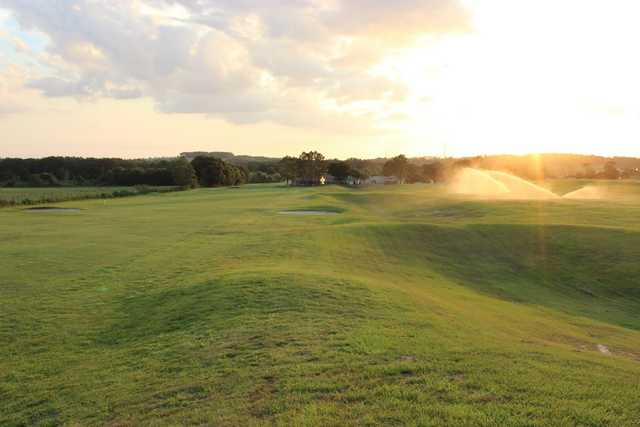 A sunset view of a fairway at Scotland Yards Golf Club.