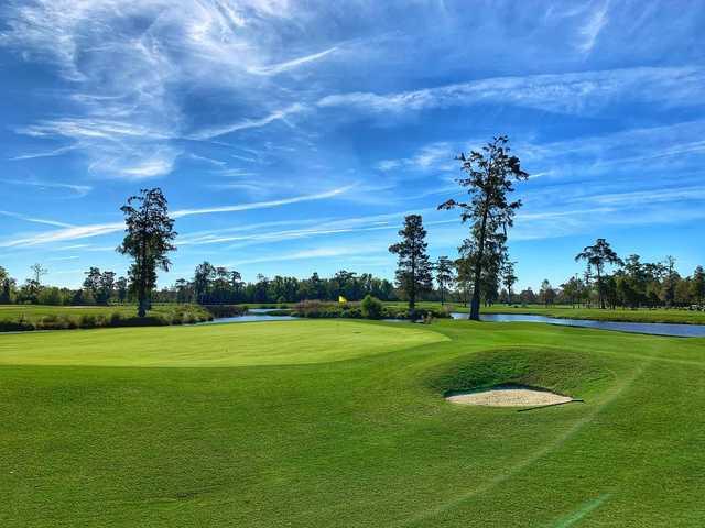 A sunny day view of a green at TPC Louisiana.