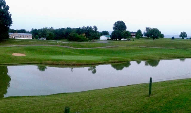 A view of a green with water coming into play at Dandridge Golf & Country Club.