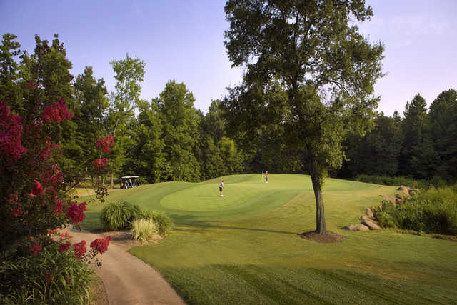 A sunny day view of a green from Rocky River Golf Club at Concord.