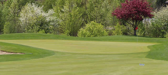A spring day view of a hole at Broken Arrow Golf Club.
