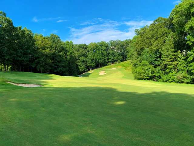 A sunny day view from a fairway at Crooked Creek Club.