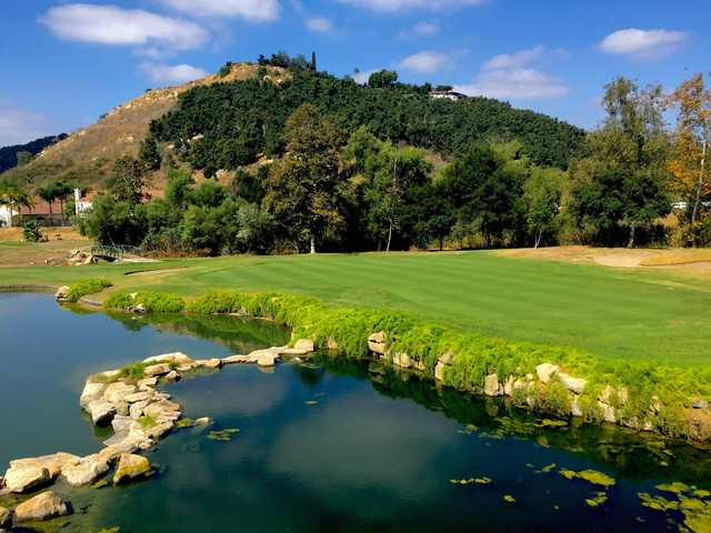 A sunny day view of a green at Eagle Crest Golf Club.