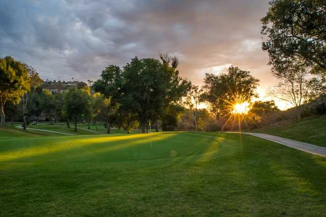 A sunset view of a hole at St. Mark Golf Course.