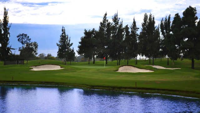 A view of a green with water and bunkers coming into play at Mile Square Golf Course.