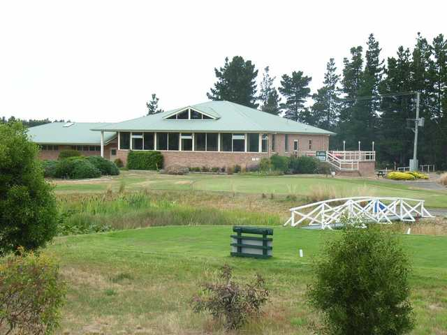 A view of a tee and the clubhouse at Llanherne Golf Club.