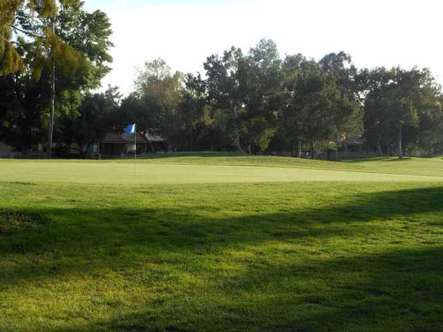 A sunny day view of a green at Upland Hills Country Club.