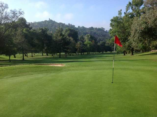 A sunny day view of a hole at Western Hills Golf & Country Club.