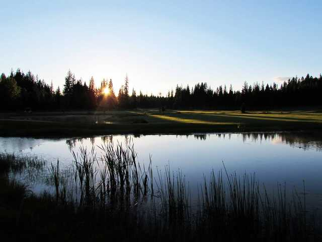 View of the 4th hole over the pond at Priest Lake Golf Club.