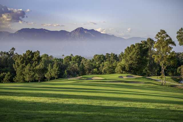A view of a green surrounded by sand traps at Los Serranos Golf & Country Club.