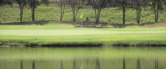 A view of a green with water coming into play at Country Club of Jackson.