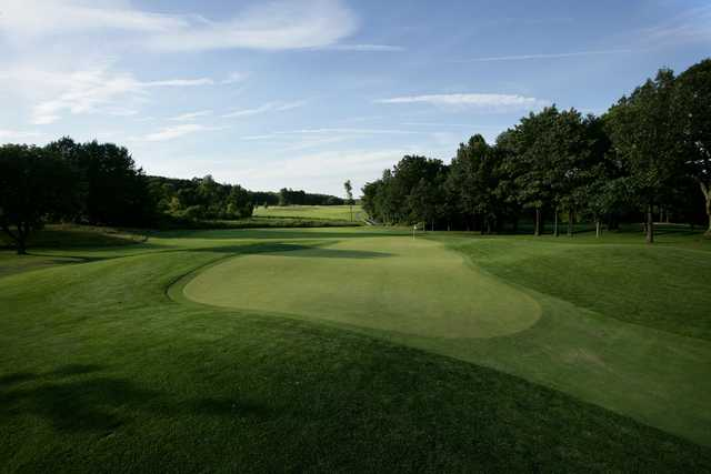 Looking back from a green at The Golf Club at Thornapple Pointe