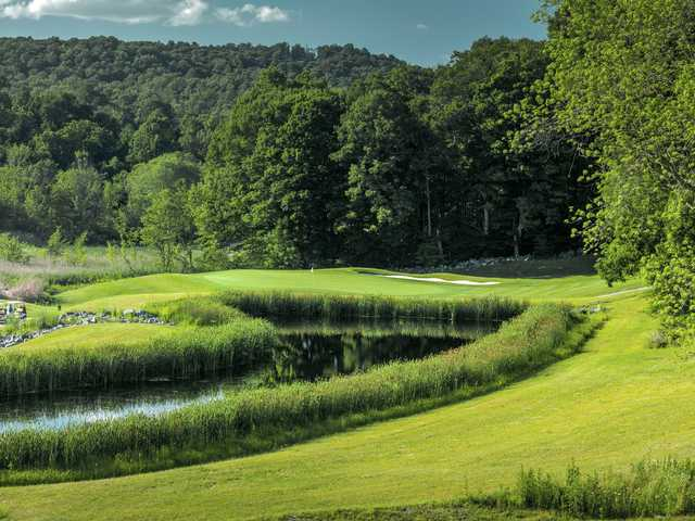 A view of a hole with water and bunkers coming into play at Putnam County Golf Course.