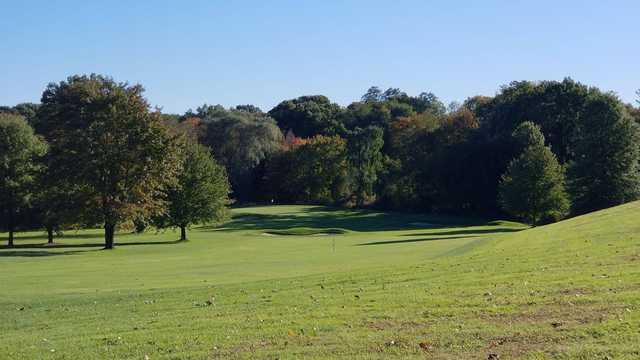 A sunny day view of a hole at Timberlin Golf Club.