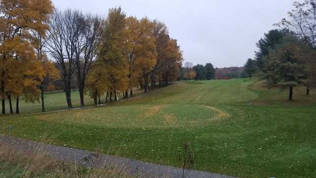 A fall day view of a hole at Timberlin Golf Club.