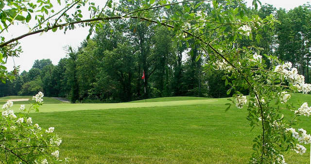 A spring day view of a green at Raritan Landing Golf Course.
